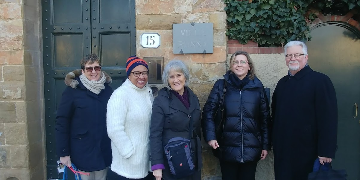 Syracuse University Provost Michele Wheatly, center; Rochelle Ford, second from left, co-chair of the University's self-study steering committee; and Petra Hejnova, interim executive director of Syracuse University Abroad, join Middle States site team chair Dr. James Bean, right, for a tour of the University's Florence Center in Italy.